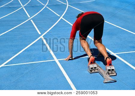 Runner ready to run on running track start line. Sport athlete going sprinting towards success on blue tracks. Sprinter on competition race challenge at stadium. poster