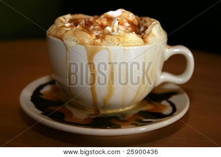 Pumpkin latte with whip cream and Carmel sauce