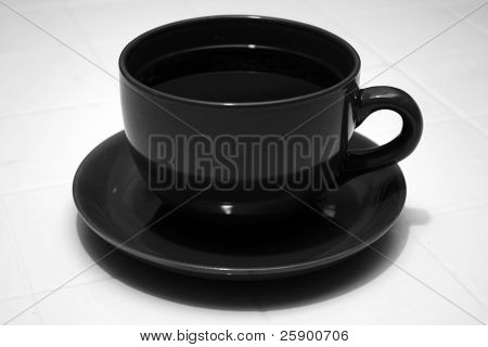 Large Cup and Saucer of fresh brewed coffee in black and white