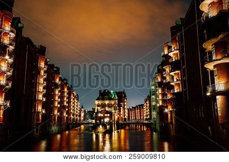 Hamburg, Germany. View Of Wandrahmsfleet At Dusk Illumination Light With Clouds Above. Located In Wa