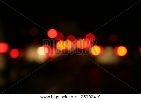 red car tail lights out of focus for backgrounds on a freeway