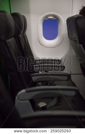 Passenger Seats, Interior Of Airplane With Passengers Seats And Window. Traveling Concept
