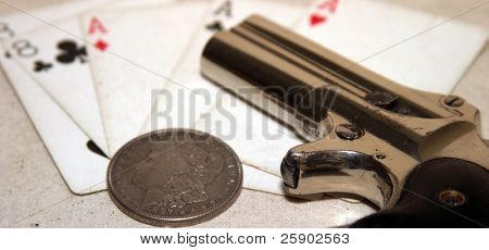 1889 darringer pistol with spare shells a  Morgan Silver Dollar, spare shells and aces and eights on canvis