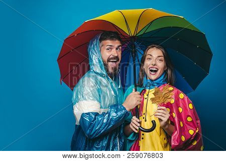 People In Rain. The Autumn Mood And The Weather Are Warm And Sunny And Rain Is Possible. Rain And Um