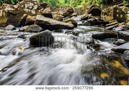 Klong Yai Kee Waterfall in tropical rain deep forest in Koh Kood island, Thailand poster
