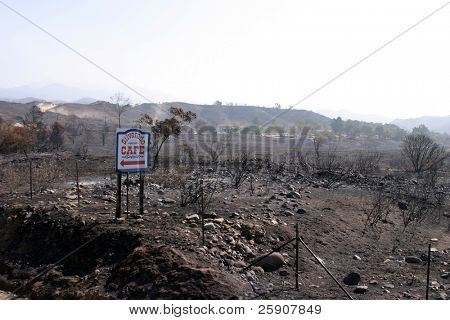 10-31-2007 Santiago Canyon Wild Fires Series. Burned landscape with the only thing not burned, a restaurant sign