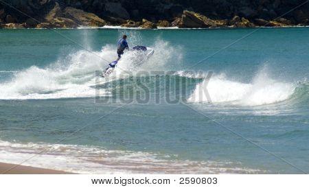Jet Ski Jumps Wave