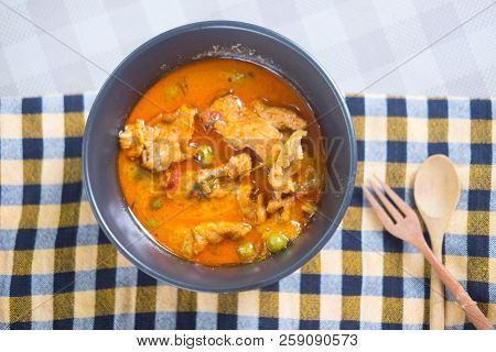Thai Red Chili Panang Curry With Pork In Black Bowl
