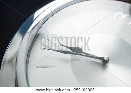 Clock hands reaching 12 clock midnight on new year 2018
