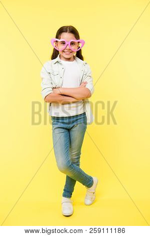 Kid Girl Heart Shaped Eyeglasses Look Confident. Girl Wear Cute Eyeglasses Confident Face. Child Con