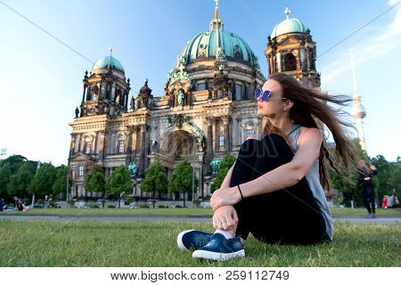 Carefree Girl Relax In Germany At Berlin Cathedral. Pretty Girl Relax On Summer Grass Near Berlin Ca