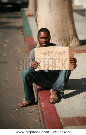 a african american male model holds a cardboard sign that reads