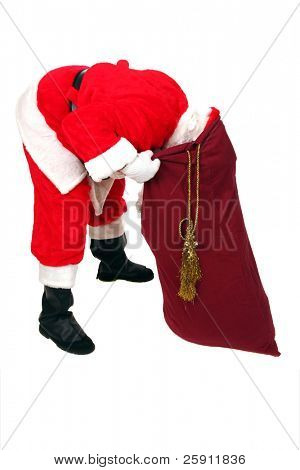 Santa Claus Looks inside his Sack for Your Special Gift isolated on white