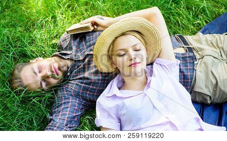 Nature Fills Them With Tranquility And Peace. Man Unshaven And Girl Lay On Grass Meadow. Guy And Gir