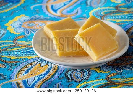 Burfi or Barfi famous Indian sweets. Popular festival food from India. Selective focus. poster