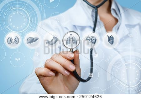 Doctor Listens To The Internal Organs On A Blue Background.