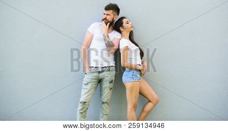 Couple Stylish Youth. Couple White Shirts Cuddle Each Other. Hipster Bearded And Stylish Girl Hang O
