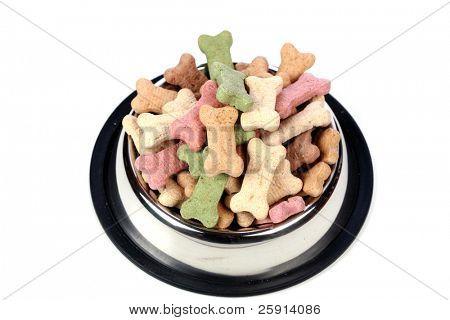 silver dog dish full of dog treats isolated on white