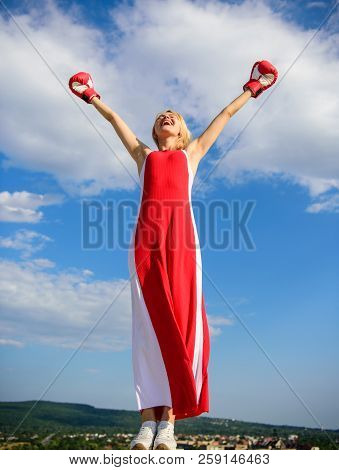 Woman Red Dress And Boxing Gloves Enjoy Victory. She Fighter Female Rights. Lady Fighter Enjoy Celeb