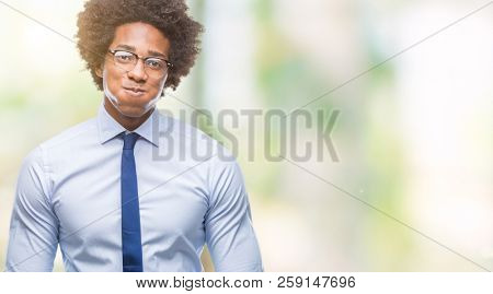 Afro american business man wearing glasses over isolated background puffing cheeks with funny face. Mouth inflated with air, crazy expression.