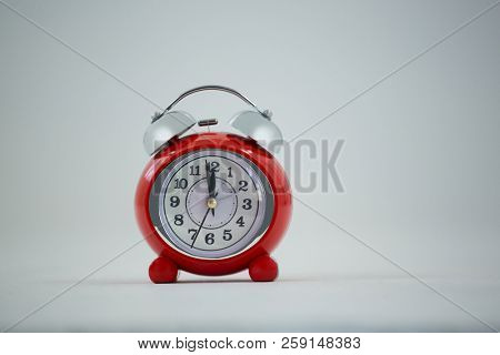Clock hands reaching 12 clock midnight on new year 2018 against white background