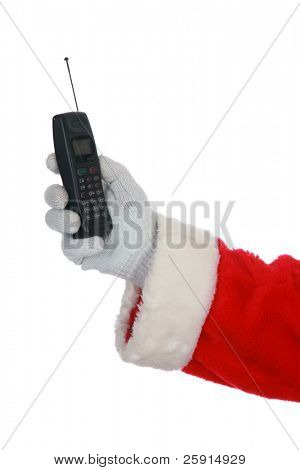 Santa holds a 1990s era cell phone  isolated on white  with room for your text