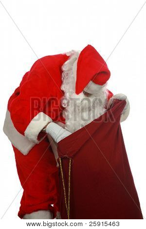 Santa looking in his magic bag of presents  isolated on white  room for text