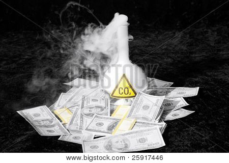 a 500ml beaker filled with CO2 infront of a pile of money, representing the business interest behind the Global Warming scare