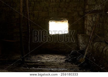 Old Rustic Clay Cowshed Interior With Window
