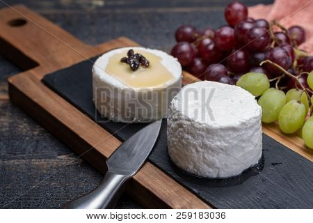 French Soft Cheeses, Variety Of Different Taste Goat Milk Natural Cheeses On Granite Plate Close Up