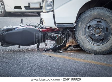 Motorcycle And Truck Head-on Accident On The Road