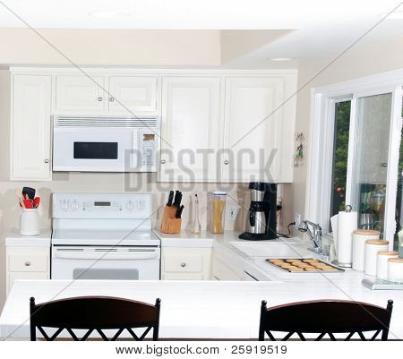 a nice modern kitchen with fresh baked peanut butter cookies on the counter