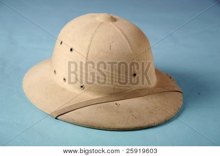 A pith helmet also known as the safari helmet, sun helmet, topee, sola topee, salacot or topi on a blue background