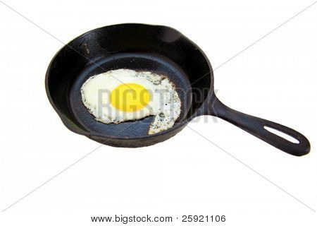 a fried chicken egg in a cast iron frying pan