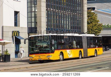 St. Gallen, Switzerland - September 19, 2018: A Postauto Bus At The Marktplatz Stop In The City Of S