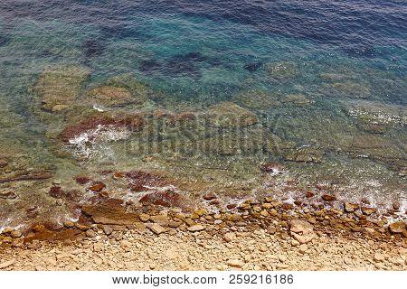 Spanish Mediterranean Rocky Coastline Beach. Turquoise Water Coastline. Horizontal