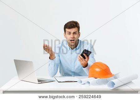Serious Man Businessman Or Engineer Sitting In Construction Site. Courageous Middle Aged Man Sit Wit