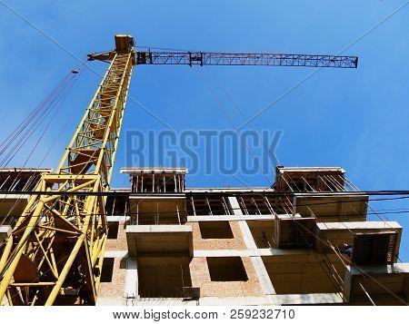 Construction Crane Near Building. Construction Site Background.