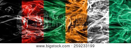Afghanistan Vs Ivory Coast Smoke Flags Placed Side By Side. Thick Colored Silky Smoke Flags Of Afgha