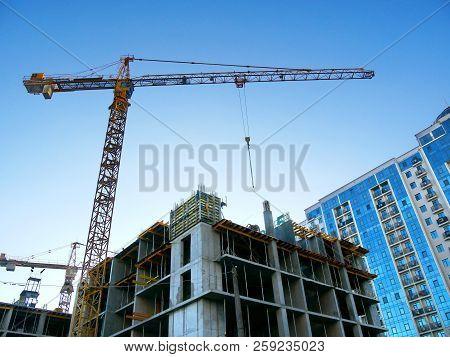 Crane Near Building Under Construction. Construction Site Background. Construction Commercial Projec