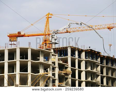 Construction Site With Crane And Building. Crane And Building Under Construction.