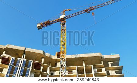 Crane And Building At The Conctruction Site.