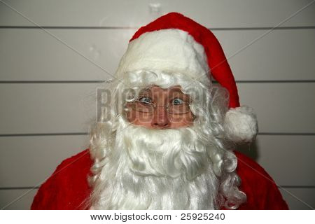 Santa Claus Mugshot. Santa is scared as his mugshot is taken for his arrest photo