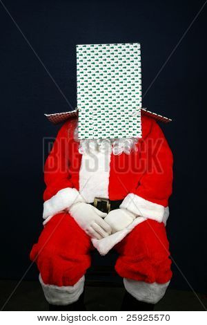 Santa Claus shows his sence of humor by looking inside and wearing a christmas present box on top of his head
