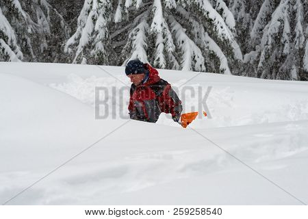 Adventurer Digs A Cave In The Snow During A Snowfall - Survival While Traveling In Winter In Wildern