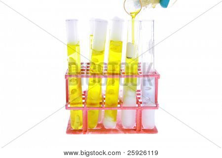 a chemist or medical research scientist adds the chemicals, CO2, H2O, and NH3, also known as