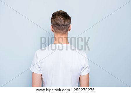 Back Rear View Photo Of Confident, Attractive, Nice-looking Man Isolated On Light Blue Background
