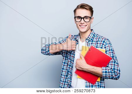Portrait Of Careless, Carefree Teen, Teenager Highschool Guy In Spectacles Hold Multicolor Copybooks