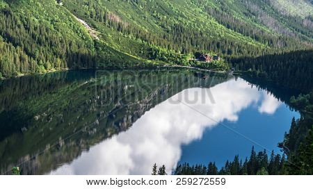 Landscape of High Tatras in the spring. Snowy mountain tops and beautiful sky. Mountain Rysy, Morskie Oko.