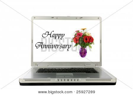 generic laptop computer with a vase of flowers and
